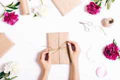Women's hands pack gifts and make decorations for the holiday. Top view Royalty Free Stock Photography