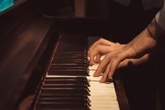Women`s hands on the piano keys, playing a melody.  royalty free stock photos