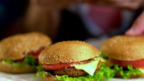 Women's hands are placed on table group hamburgers. 4k. stock footage