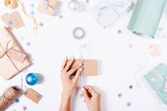 Women's hands prepare gifts and decorations. For Christmas, view from above Stock Photography