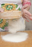 Women's hands preparing flour before baking pie Stock Image
