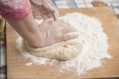 Women's hands preparing fresh yeast dough Stock Image