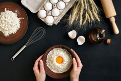 Women`s hands are preparing home-made raw noodles, Rustic, Selective Focus, Atmospheric dark tone. Food flat lay on kitchen table background. Working with Stock Photo