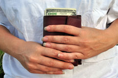 Women's hands and purse with dollars Royalty Free Stock Image