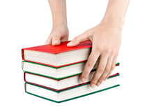 Women's hands reach for the books. On white background stock images