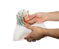 Women's hands reach envelope of cash fan Stock Image