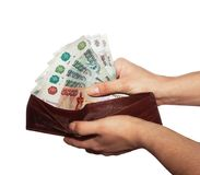 Women's hands reach from the wallet of cash fan Stock Image