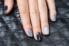 Women's hands with a stylish manicure Stock Images
