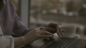 Women's hands typing on computer RUSSIAN keyboard. Closeup of business woman hand typing on laptop keyboard. Closeup of a female hands busy typing on a laptop stock video footage