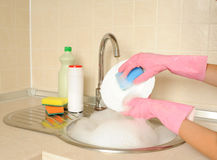 Women's hands washing dish Royalty Free Stock Photos