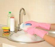 Women's hands washing dish Stock Image