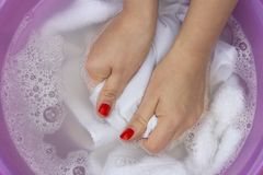 Female hands washing white clothes in basin stock photography