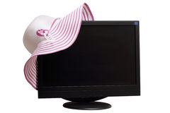 Women's hat and monitor Royalty Free Stock Photo