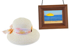 Women's hat and photographic frame Royalty Free Stock Images