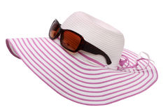 Women's hat and sunglasses Stock Photos