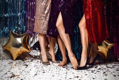 Women`s heels celebrating new year, birthday , having fun, dancing,drinking alcohol cocktails . Crazy party time of three beautiful stylish women in elegant royalty free stock image