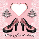 Women's high heel shoe, label , chandeliers Stock Photography