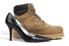 Women's High-Heel Shoe Beside Workboot Stock Image