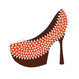 Women's high-heeled red shoes decorated with studs Stock Photo