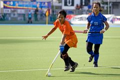 Women's Hockey. Women hockey players in action at the Malaysia Games Women's Hockey semi-final match between the Malaysian states of Pahang and Penang, held at Stock Image