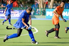 Women's Hockey. Women hockey players in action at the Malaysia Games Women's Hockey semi-final match between the Malaysian states of Pahang and Penang, held at Royalty Free Stock Image
