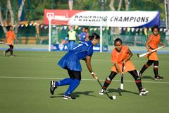 Women's Hockey. Women hockey players in action at the Malaysia Games Women's Hockey semi-final match between the Malaysian states of Pahang and Penang, held at Royalty Free Stock Photography