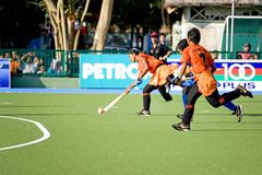 Women's Hockey. Women hockey players in action at the Malaysia Games Women's Hockey semi-final match between the Malaysian states of Pahang and Penang, held at Royalty Free Stock Photo