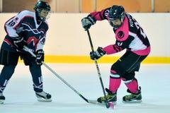 Women`s hockey. Hockey match `Pantery` vs `Lavina`. Ukrainian women hockey championship Royalty Free Stock Images