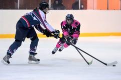 Women`s hockey. Hockey match `Pantery` vs `Lavina`. Ukrainian women hockey championship Stock Image