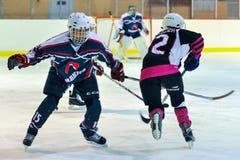 Women`s hockey in Ukraine. Hockey match `Pantery` vs `Lavina`. Ukrainian women hockey championship Stock Image