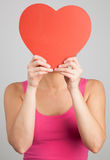 Women's holding heart shape Stock Photography