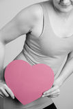 Women's holding a pink heart shaped Stock Photo
