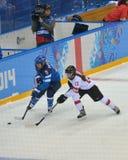 Women's ice hockey match Finland vs Switzerland. Sochi, Russia - February 12, 2014: Women's ice hockey match Finland vs Switzerland in Shayba arena during Royalty Free Stock Image
