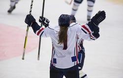 Women's Ice Hockey. Player shoots the puck Stock Photo