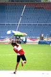 Women's Javelin Throw for Disabled Persons. A participant in a women's javelin throw event. This event was carried out in light drizzle stock images