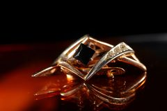 Women`s jewelry made of gold and shot close-up stock photos