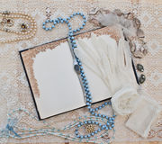 Women's jewelry and notebook Stock Image