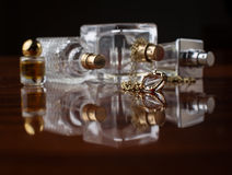 Women's jewelry and perfume Stock Photography