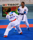 Women's karate competition. BEIJING-AUGUST 31: American Fonseca Elisa Au (RED) fight against WILLIAMS Natalie of Great Britain (Blue) during the Karate Royalty Free Stock Photo