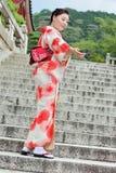 Women`s kimonos post for photo within Fushimi Inari shrine Stock Photo