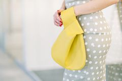 Women`s leather bag in the hands of a stylish girl royalty free stock images
