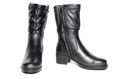 Women`s leather black boots. On white background, isolated, studio royalty free stock images