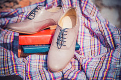 Women's leather shoes with laces are on a checkered tablecloth Royalty Free Stock Photography