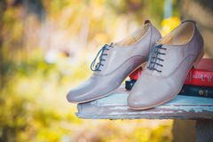 Women's leather shoes with laces are on a checkered tablecloth Royalty Free Stock Photo