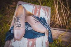 Women's leather shoes with laces are on a checkered tablecloth Royalty Free Stock Image