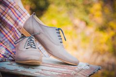 Women's leather shoes with laces are on a checkered tablecloth Stock Photography