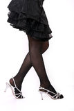 Women's legs. Black skirt, black stockings. Women's legs and shoes on white Stock Images