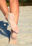 Women's legs on a beach Stock Photo