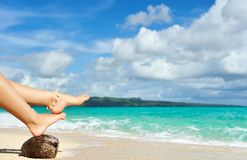 Women's legs on a beach Stock Images