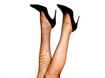 Women`s legs in pantyhose and high heels. Black color Royalty Free Stock Images